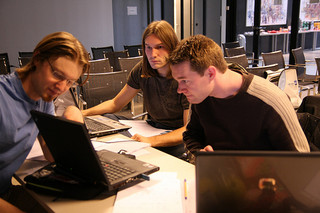 3 students working on a laptop