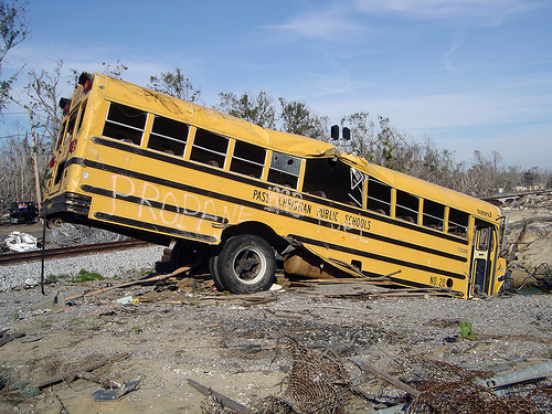 Damaged school bus sits among wreckage in Post-Hurricane Katrina Mississippi