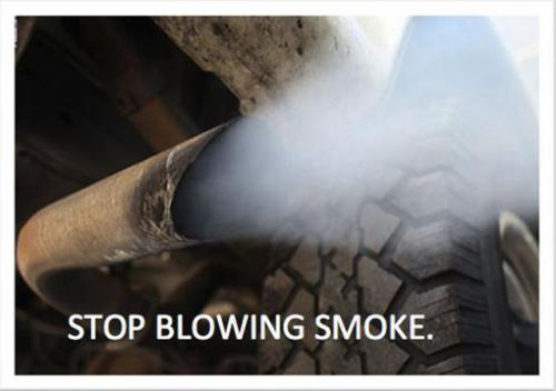 Photo of car exhaust pipe with text STOP BLOWING SMOKE.