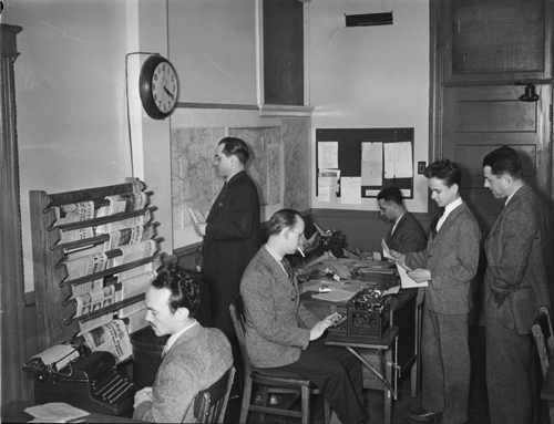 Image of journalists in the Radio-Canada/CBC newsroom in Montreal, Canada