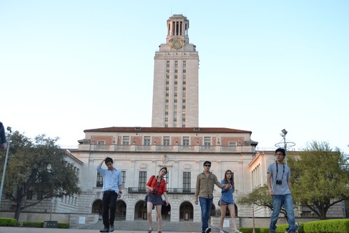 students posing in front of UT tower