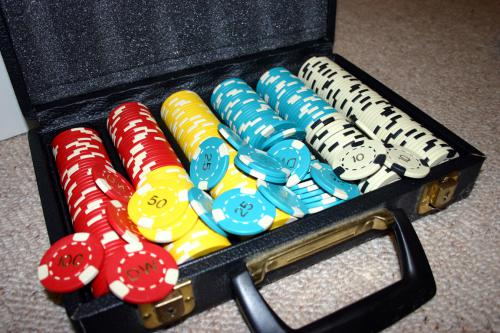 Set of multicolored poker chips in case