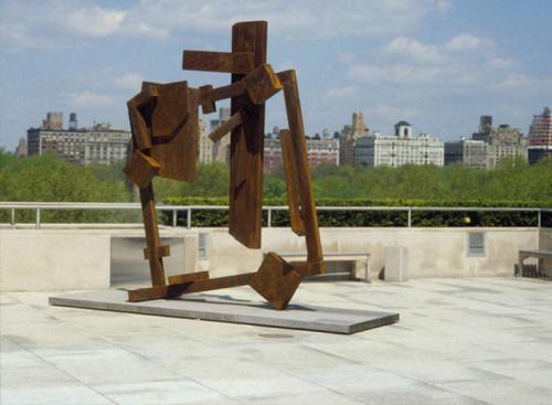 Joel Perlman sculpture Square Tilt framed by city skyline