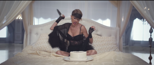 "Picture shows Taylor Swift about to stab a cake, an image from her video for ""Blank Space."""