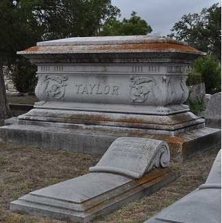Large family memorial in rear with individual gravestone in front.