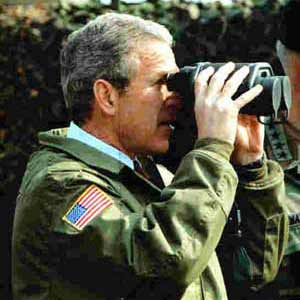 George W Bush holding binoculars
