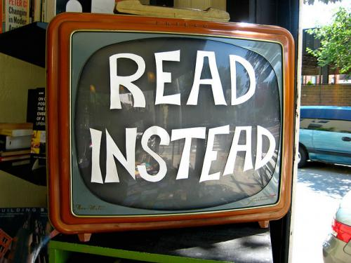 Vintage television with the words Read Instead posted on the screen